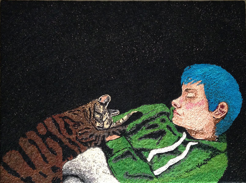 hand embroidered portrait of boy with cat